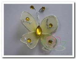 Vlinder Goudgeel glitter/diamantje 3. 5cm. Vlinder Goudgeel