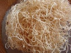 Curly mos 500 gram. bleached of naturel - bruin-naturel  Curly mos 500 g