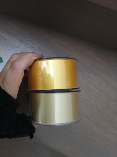 Geel Lint 70 mm met zwarte opdruk 80 cm. Bedrukt Lint 70mm