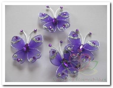 Vlindertje paars 3, 5 cm./stuk Vlindertje paars 3, 5 cm.